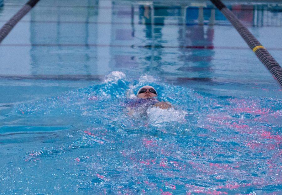 Quinn Marshall swimming backstroke.
