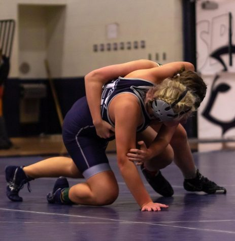 Grace Snyder fights to get her opponent back on the ground.