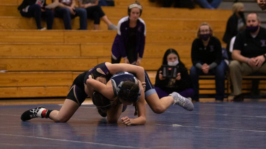 Watkins works to pin her opponent down.