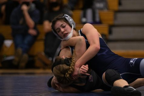 Gabi Hellmann holds the girl on the mat.