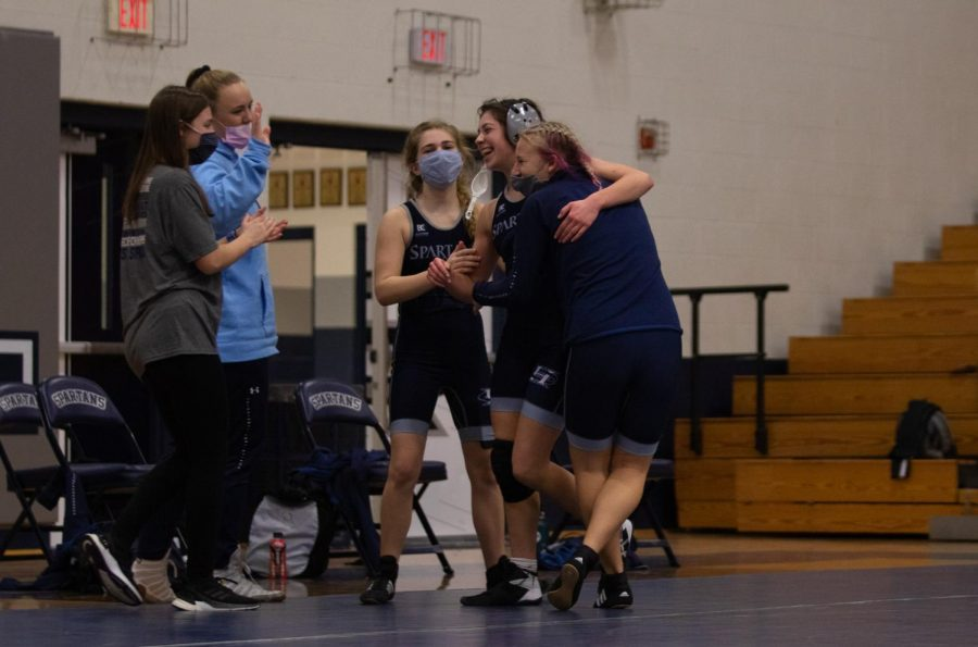 Spartans celebrate after Gabi finishes her winning match.