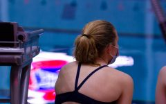 Lianna Durbin watches the divers compete.