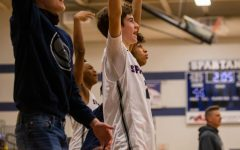 Sophomore Connor Casler and teammates celebrating a well executed play by their players on the court.