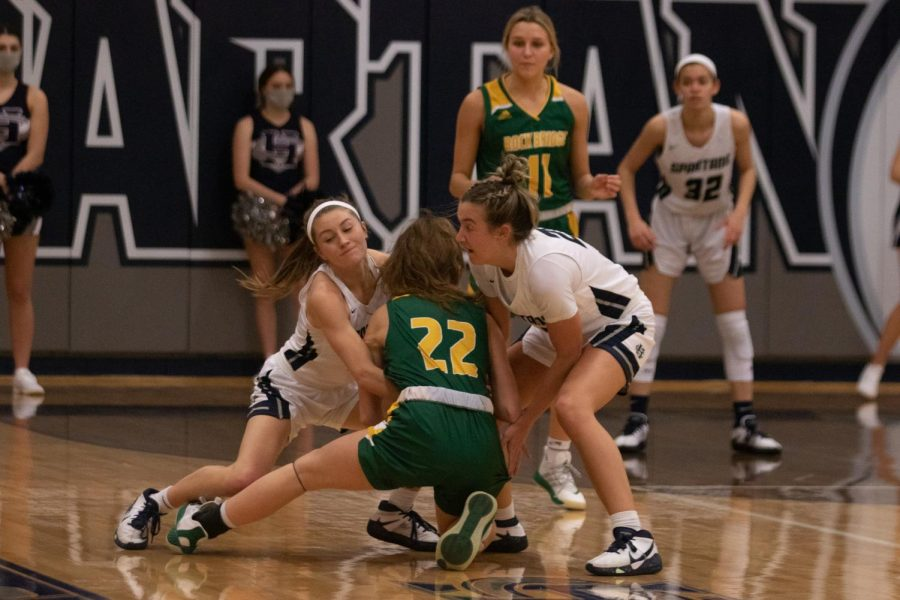 Gracie Stugart and Rylee Denbow work to pull the ball from an opposing player.