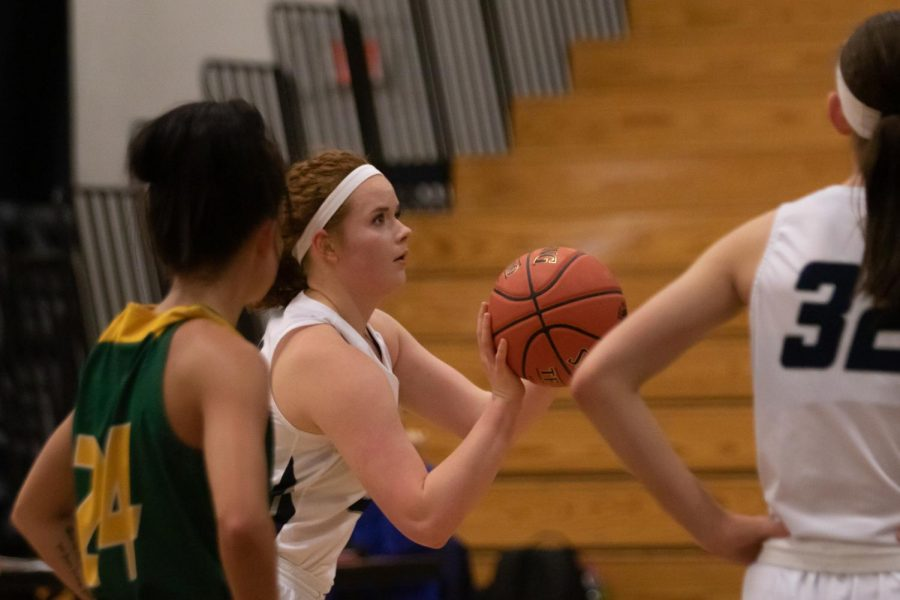 Sophie Delaney keeps her eyes on the basket during a free throw.