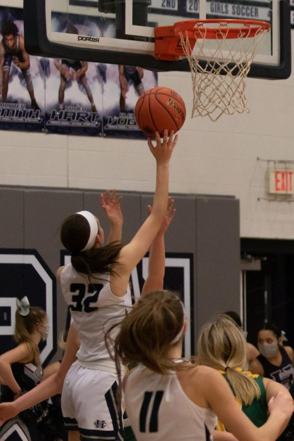 Trinniti Matthews jumps above everyone as she goes up for a shot.