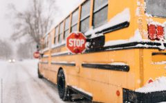 A school bus braves an icy terrain in spite of the dangerous nature of the cold. This bus's school made the risky decision to conduct school as usual.