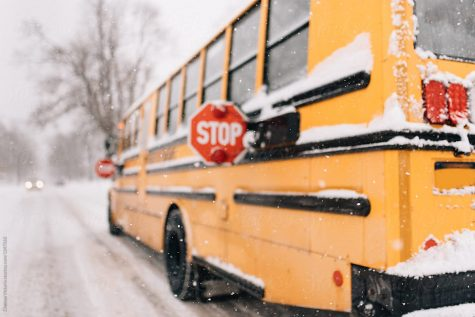 A school bus braves an icy terrain in spite of the dangerous nature of the cold. This bus