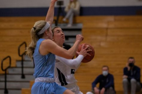 Junior Rylee Denbow going for a layup.