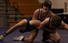 Sophomore Peyton Shepard attempts to work a tilt on a difficult opponent.