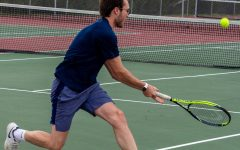 Ed Hritzkowin sprints to reach a forehand shot.