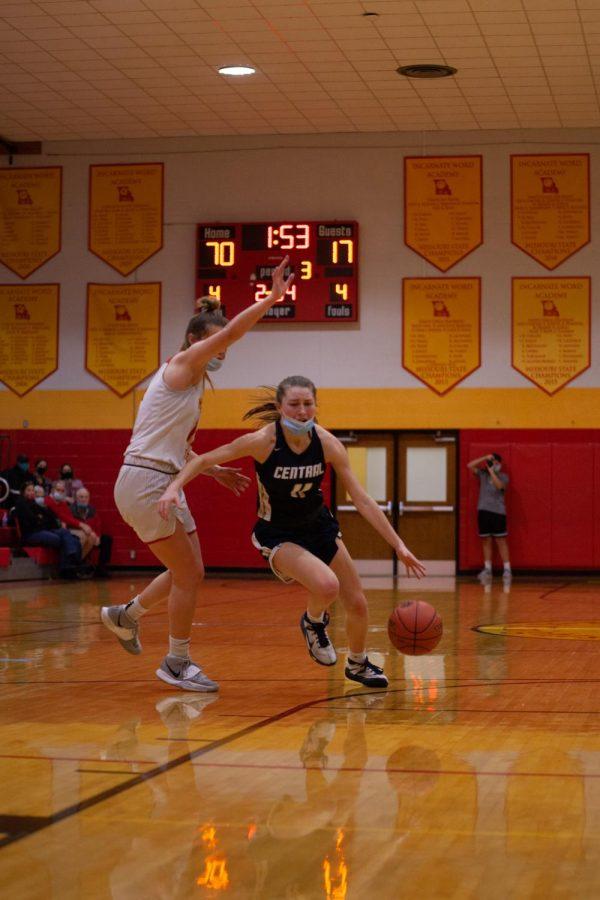 Senior Gracie Stugart attacking the basket