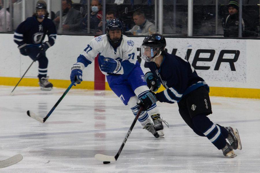 Brett Robinson, senior, trying to skate away from the apposing team.