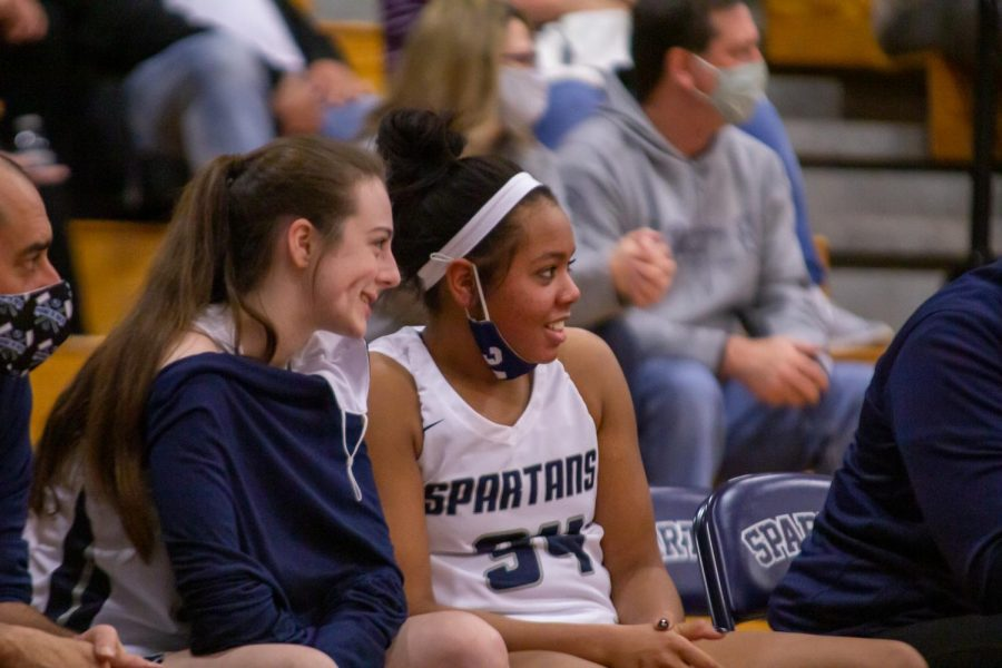 Nikki Crangle and Bri Mason watch their teammates play.