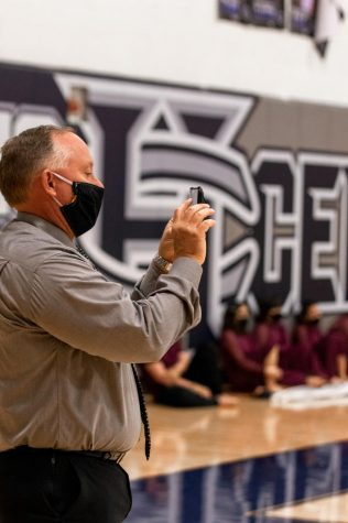 Principal, Sonny Arnel Capturing the awesome drum line performance.