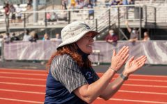 Coach Baize cheering on her long distance athletes
