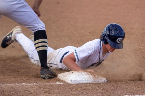 A Spartan player slides at first.