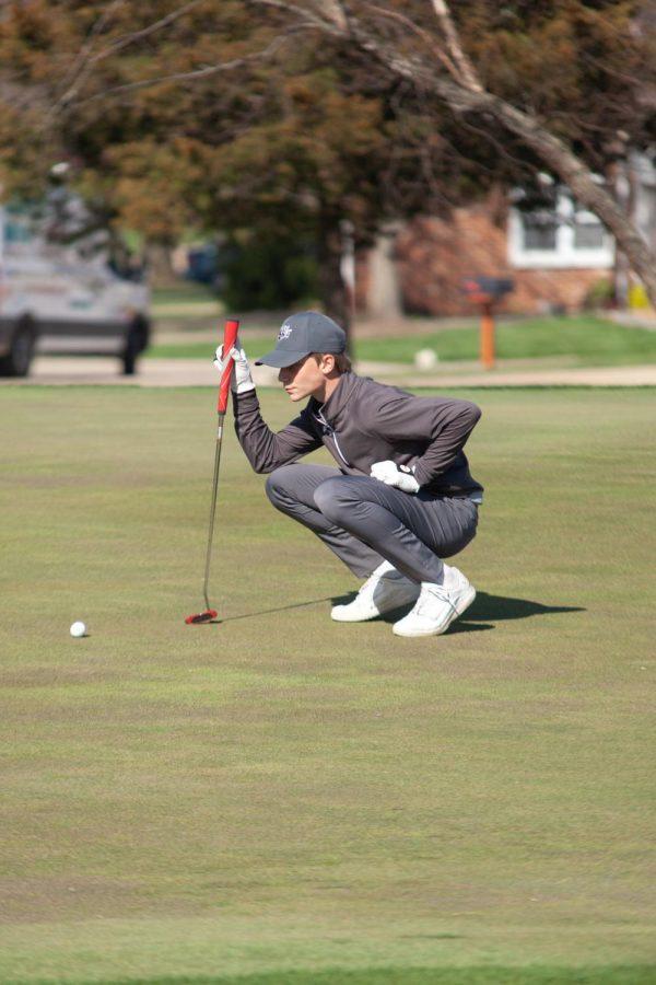 Sophomore Dalton Dawson lining up his put on the green