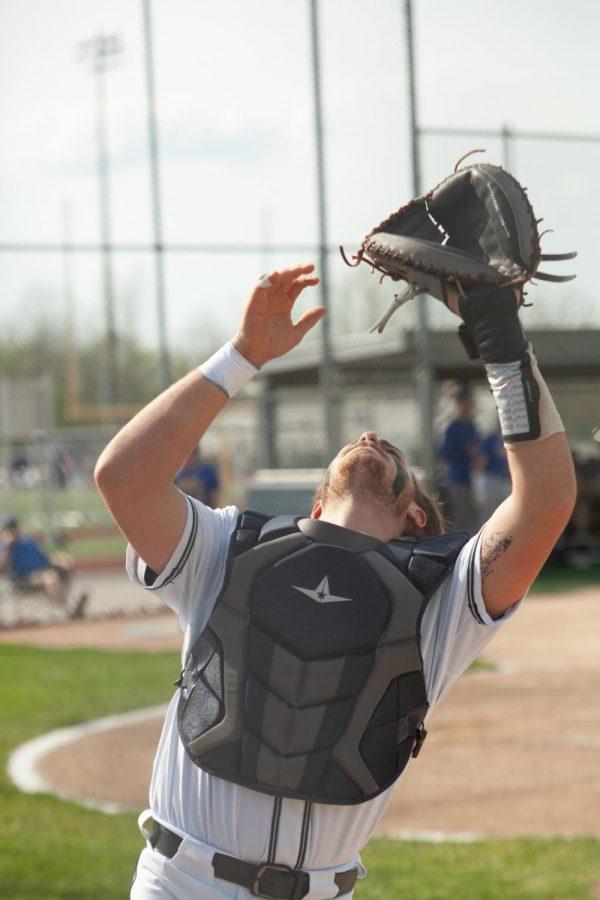 Senior Owen aNgel catching a pop fly
