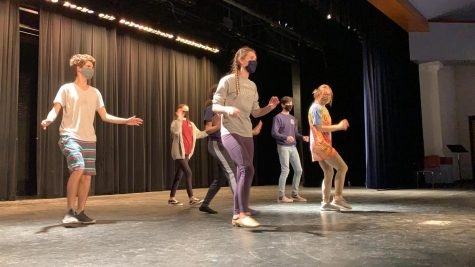 The cast of the spring musical dances on the stage in the auditorium. Due to limited time to work together, the cast tries to make the best use of the time they are allowed to have to rehearse for the show.