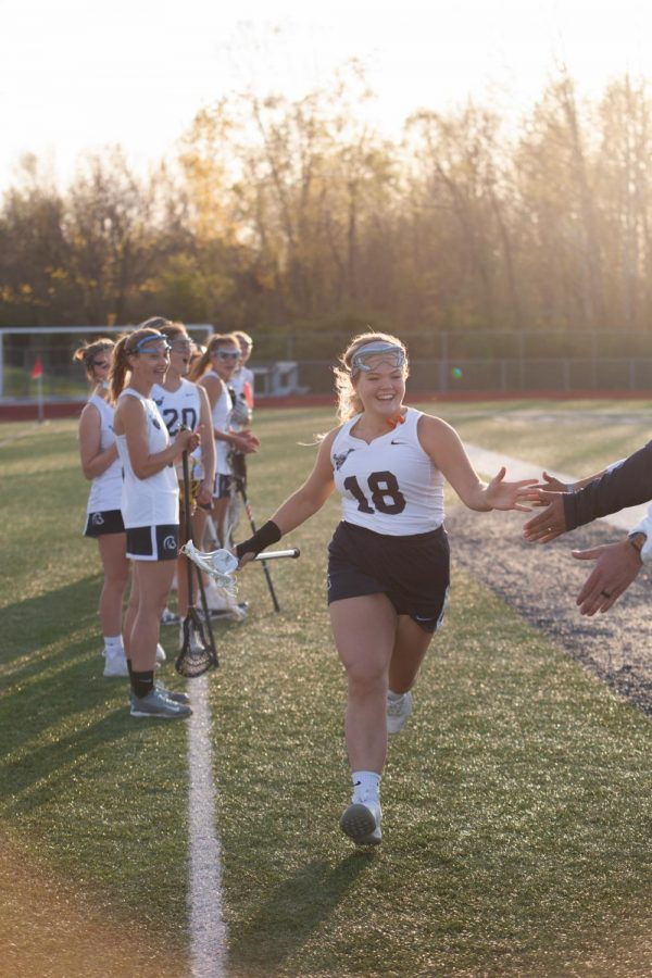 Junior Keaton Frye high fiving the coaches as her name was called for the starting lineup.