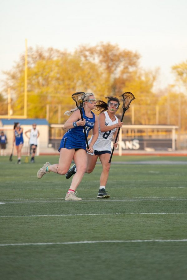 Junior Clara Kilen trying to ride the opponent out to the sidelines.