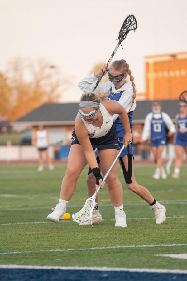 Junior Keaton Frye picking up a ground ball, dropped by the other team.