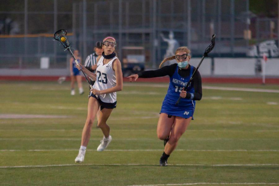 Junior Chloe Schwab running towards the goal with hopes of scoring.