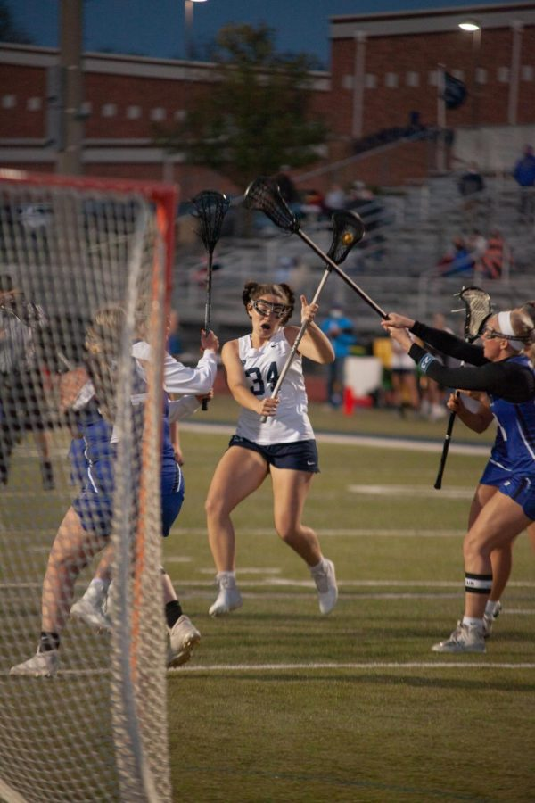 Sophomore MaryGrace Cummings attempting to score.