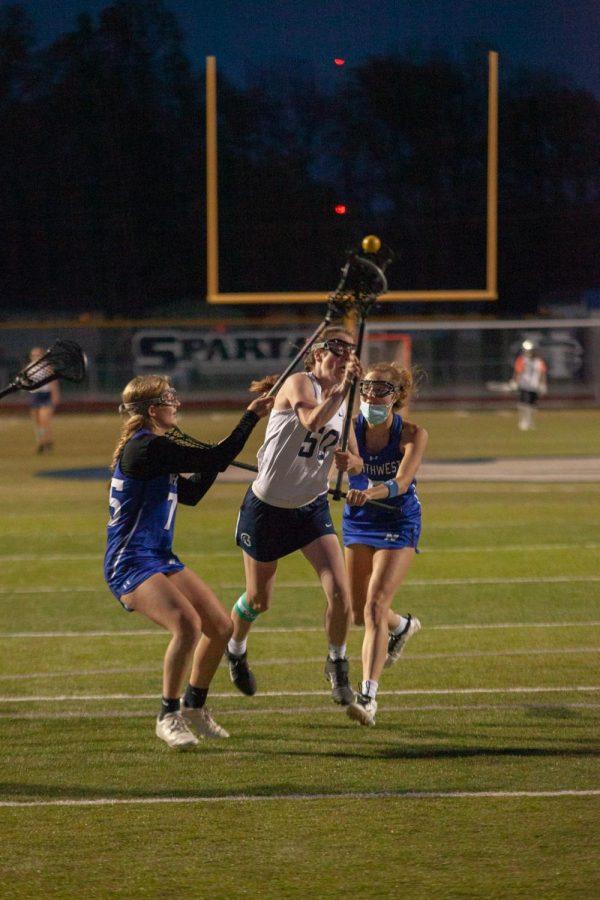 Senior Nikki Crangle attempting to score in overtime.