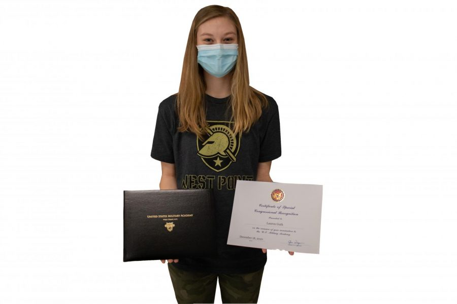 Lauren Guth poses with her Congressional Nomiation certifcate and acceptance booklet. Guth went through a multitudinous process composed of essay-writing and interviews in order to get accepted by West Point Academy, where she plans to attend in order to serve her country and earn a degree.