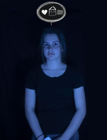 A teenage girl basked in blue light stands with a stoic expression cast onto her face. Above her, a thought bubble floats; it encompasses the causes of her mental distress: relationship and communication issues, home troubles and overwhelming school work. All are example of potential factors that affect mental health.