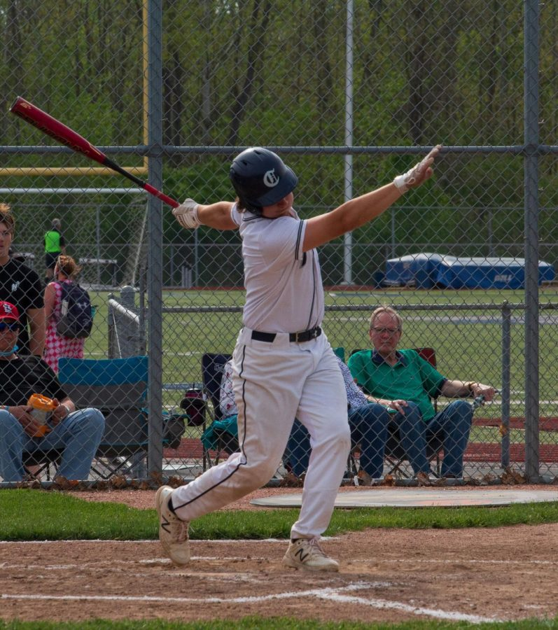 Junior Brendan Jones hits the ball far out toward Holt.