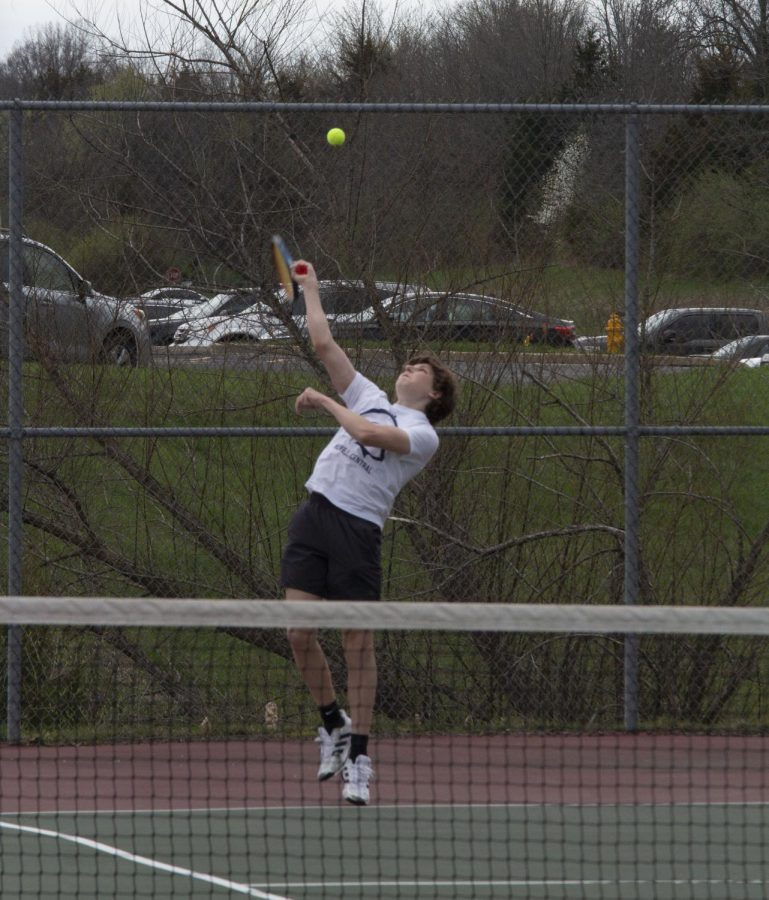 Junior Drew Black preparing to hit the ball at a practice.
