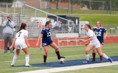 Junior Madi Marstall keeping the ball away from the other team.