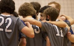 The boys huddle together after a game at districts, preparing to go back onto the court.
