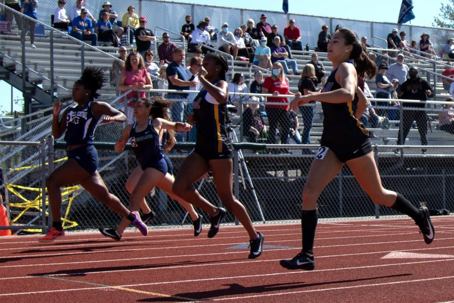 Senior Monica Anderson surges ahead in her sprint at GACs.