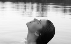 FHN student Eva Kaminski gazes at the sky while immersed in the freezing cold waters of the Klondike Park lake. I like this photo mostly because of her profile reflected perfectly in the water. I also really like the contrast between the lights and darks in the photo.