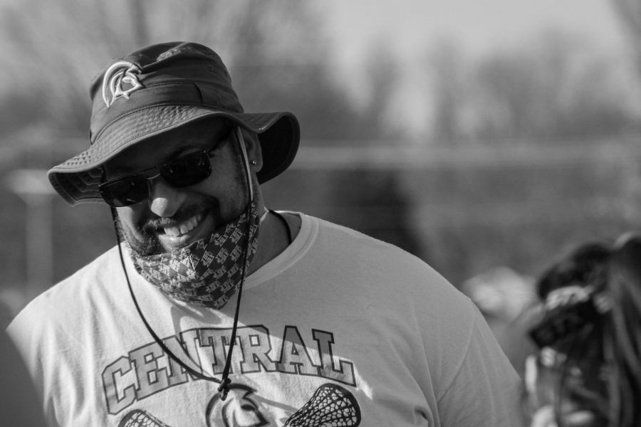 Coach Winningham laughing while talking to his team.