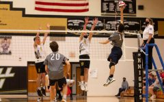 Junior Jacob Simpkins jumping to spike the ball.