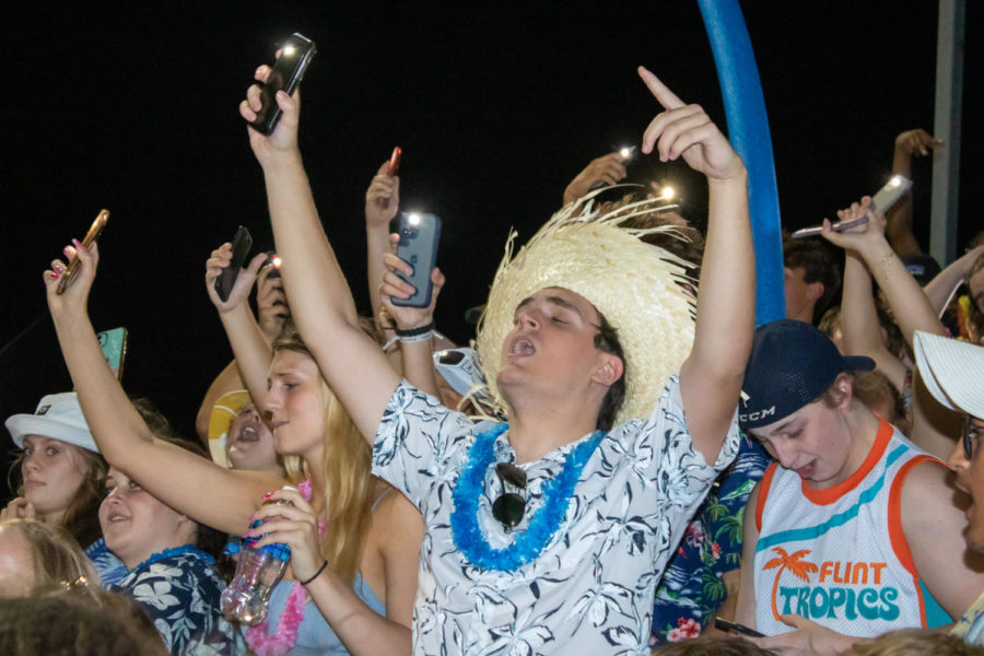 Senior, Bobby Soderstrom sings in the stands.