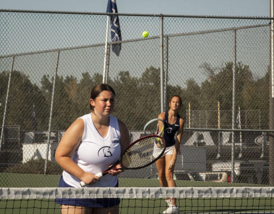 Junior Sophia Miller hits the ball towards sophomore Haileigh Morrissey.
