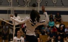 Shae Pearson jumps high to spike ball.
