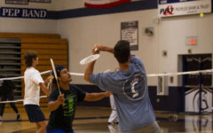 """Taking a Swing: Seniors Jayden Jones (left) and Cameron Hill (right)play badminton in their seventh hour Net Sports class. """"The three main sports we cover are badminton, volleyball, and tennis. We also play pickleball,"""" Coach Jennifer Denny, who teachers the class, said."""