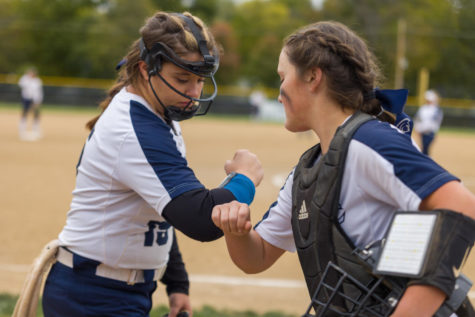 Senior Kennedy Jensen and sophomore Phoebe Miller bumping elbows during the state quarterfinal game, which was suspended after 11 innings with the score even at two. The girls softball team is a well oiled machine who are ready to continue in tonights game.