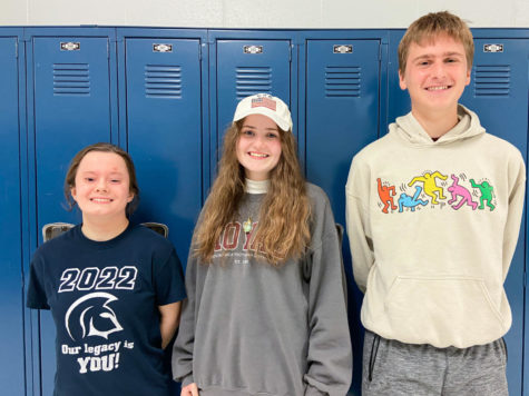 Seniors Anna Baranowski, Hannah Bernard and Jack Schriber line up in front of a set of lockers. All three of the students have been named National Merit Scholars based on their PSAT scores from junior year. In addition, both Baranowski and Bernard were named semifinalists, meaning that they are eligible to apply for the National Merit Scholarship.