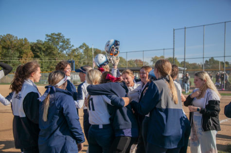 The girls softball team celebrates with their friends and family after winning against Troy. The game was hard fought and the win was celebrated even harder.