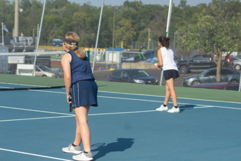 Bethany List and Lindsay Way get ready to start their doubles match.